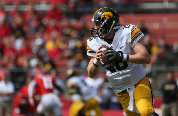 Iowa quarterback C.J. Beathard looks down field for an open player during the Iowa-Rutgers game at High Point Solution Stadium at Piscataway on Saturday, Sept. 24, 2016. The Hawkeyes defeated the Knights, 14-7. (The Daily Iowan/Margaret Kispert)