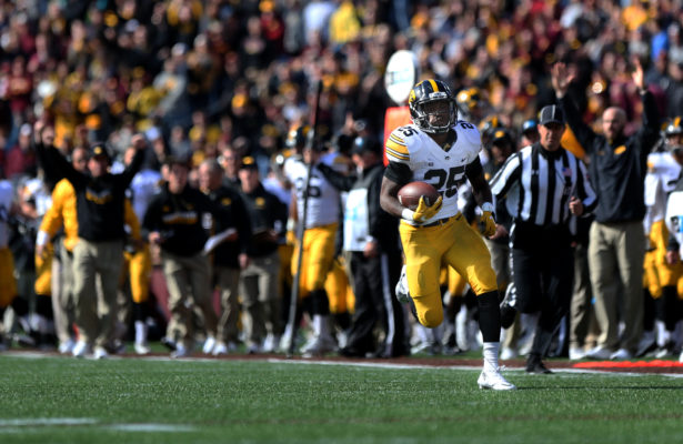 Iowa running back Akrum Wadley runs in for 54-yard touchdown during the Iowa-Minnesota game at TCF Banks Stadium in Minneapolis on Saturday, Oct. 8, 2016. The Hawkeyes defeated the Golden Gophers, 14-7. (The Daily Iowan/Margaret Kispert)